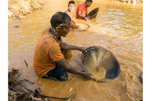 man is panning for gold