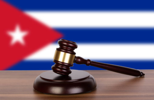 Wooden gavel and flag of Cuba