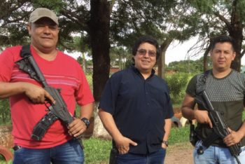 Journalist Cándido Figueredo (center) lives with armed guards around the clock. (Courtesy)