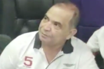 Honduran journalist David Romero is arrested after police raid his radio station Radio Globo. (Screenshot from Radio Globo video on Facebook)