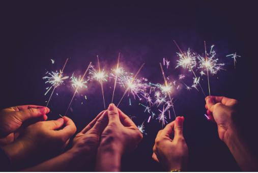 hands holding sparklers