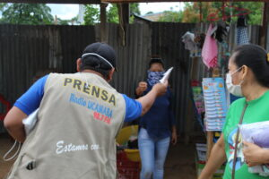 Man distributes material in Peruvian communities